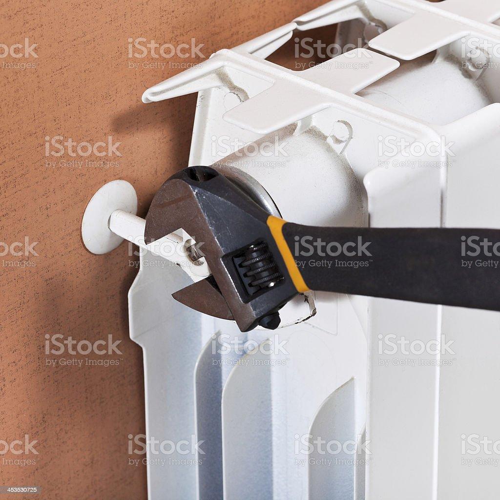 adjusting heating radiator royalty-free stock photo