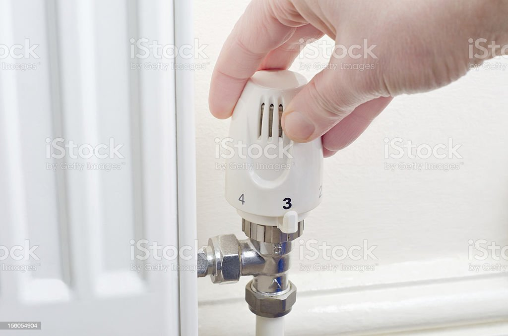 Adjusting Heating Temperature royalty-free stock photo