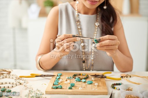 istock Adjusting parts of earring 640933402