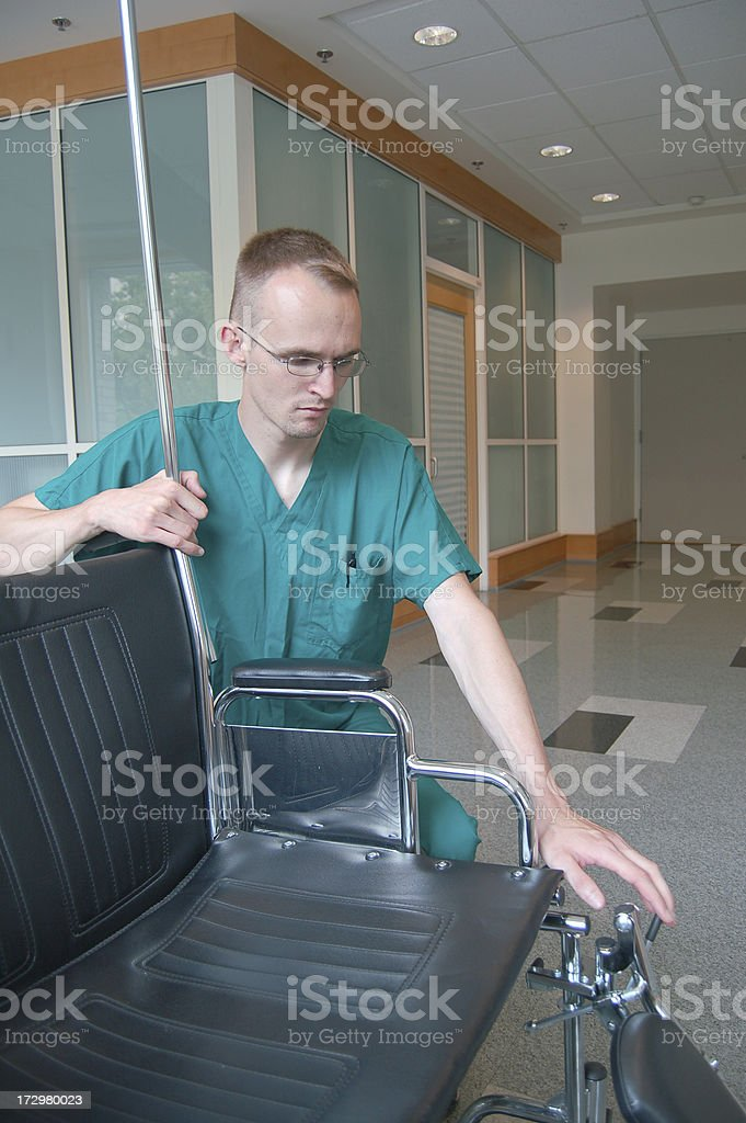 Adjusting the Chair royalty-free stock photo