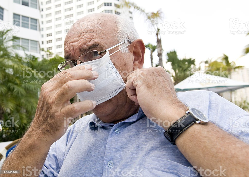 Adjusting the flu mask royalty-free stock photo