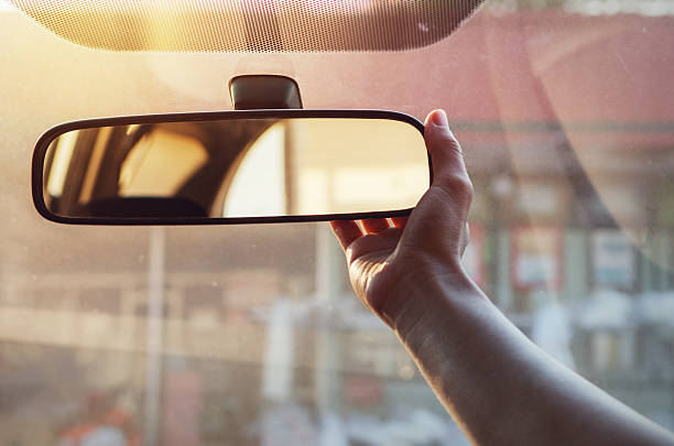 Adjusting the rear view mirror stock photo