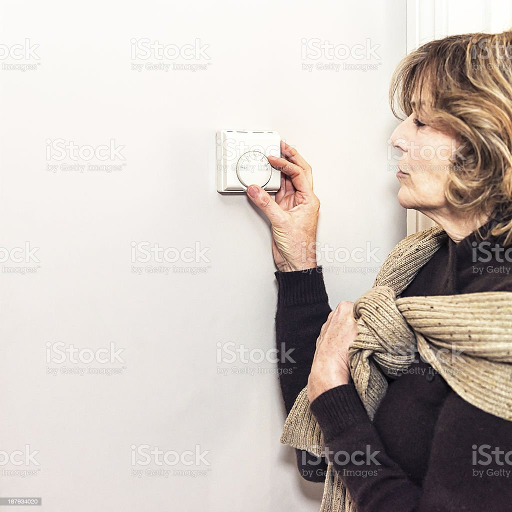 Adjusting the thermostat stock photo