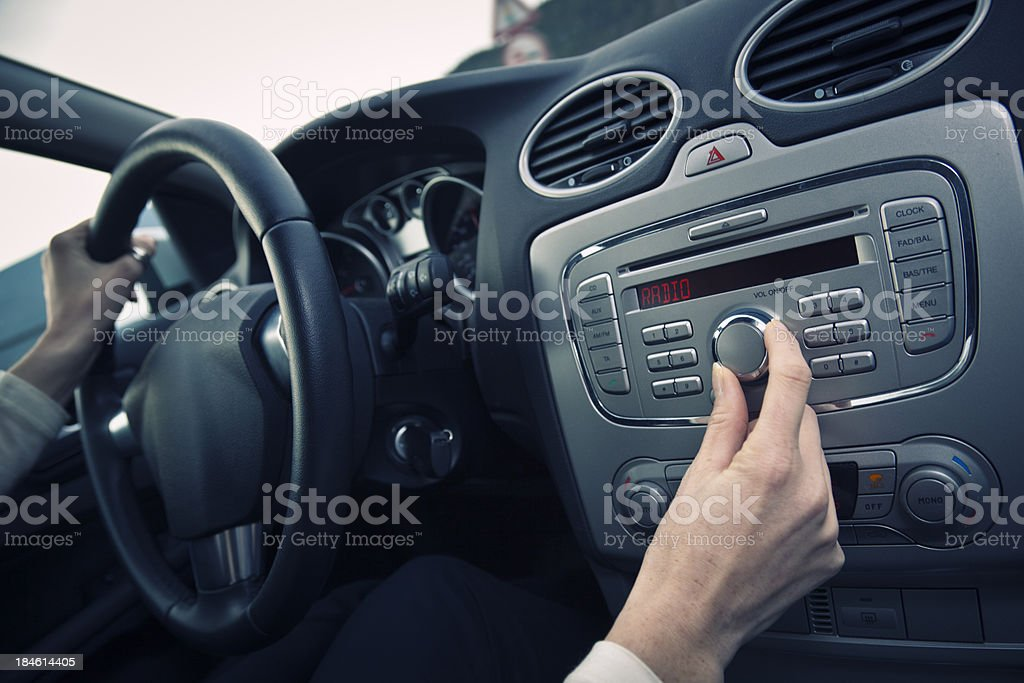 adjusting the volume stock photo
