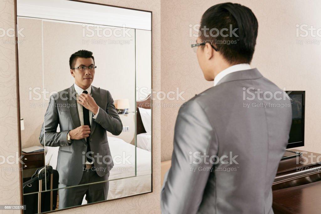 Adjusting tie stock photo