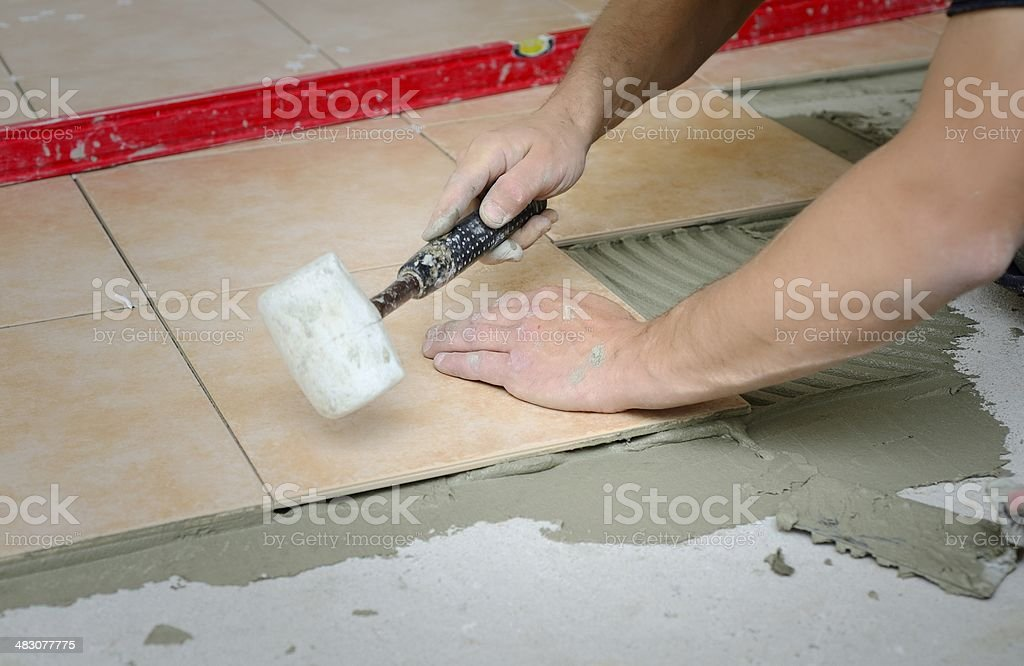 Adjusting tiles stock photo