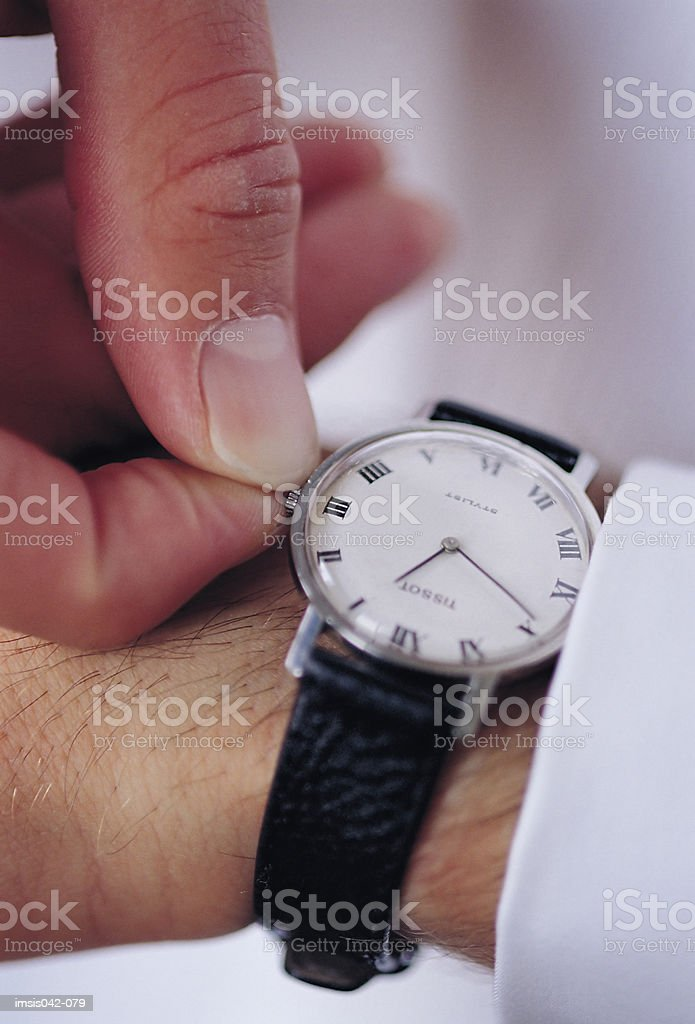 Adjusting watch royalty-free stock photo