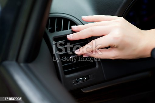 istock adjustment of air flow from an air conditioner in a car 1174502003