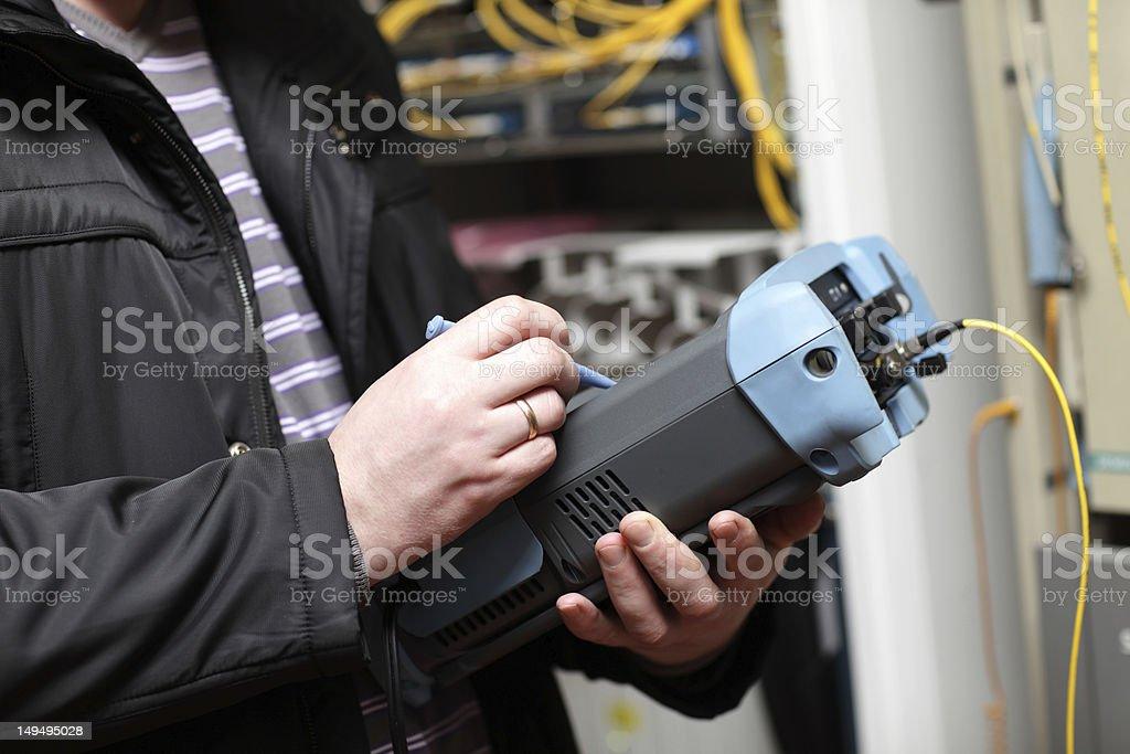Adjustment of fibre optic reflectometer stock photo