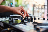 istock DJ adjusts the volume on the turntable at a party. 1256579050