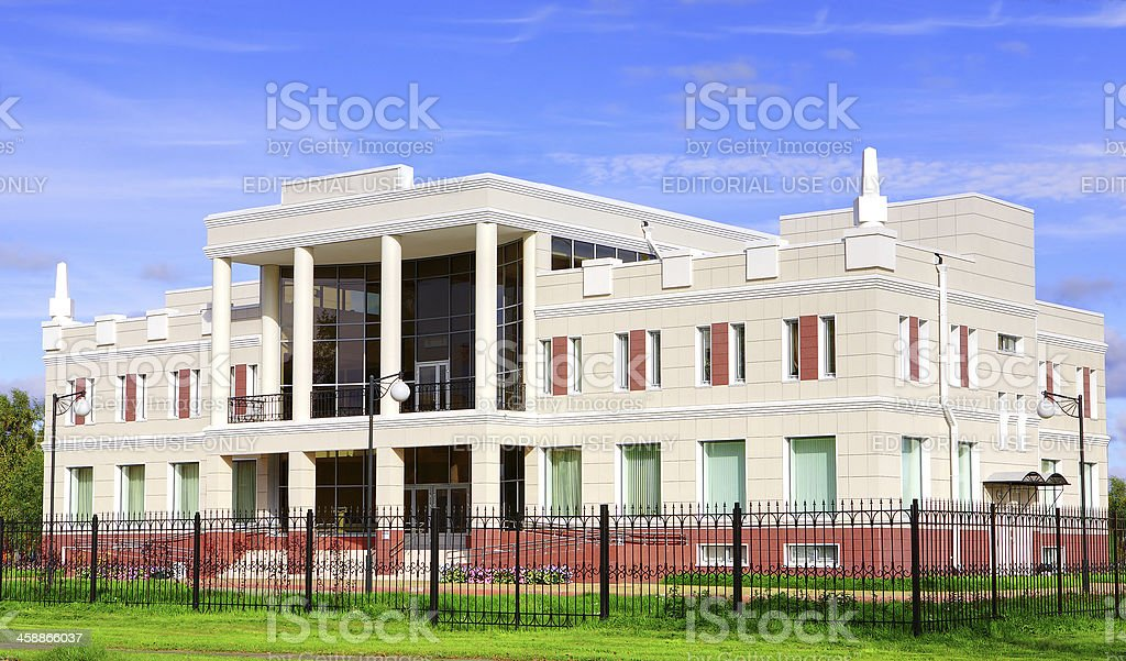 Administrative building of two stories high, white, with columns royalty-free stock photo