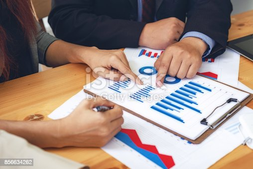 656005826istockphoto Administrator business financial inspector and secretary making report, calculating or checking balance. Internal Revenue Service inspector checking document. Audit concept 856634262