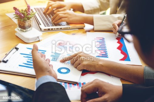 656005826istockphoto Administrator business financial inspector and secretary making report, calculating or checking balance. Internal Revenue Service inspector checking document. Audit concept 856634280