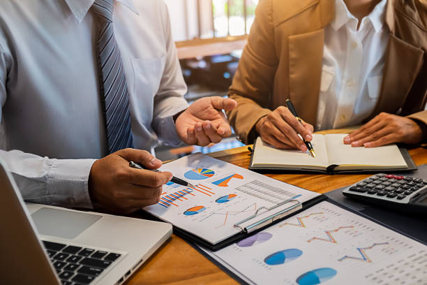 Administrator business man financial inspector and secretary making report calculating balance. Internal Revenue Service checking document. Audit concept stock photo