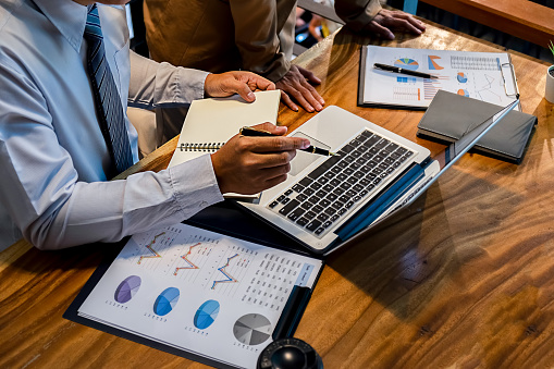 istock Administrator business man financial inspector and secretary making report calculating balance. Internal Revenue Service checking document. Audit concept 1135581630