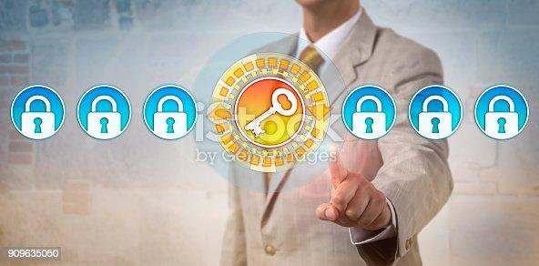 istock Administrator Highlighting Key In Row Of Locks 909635050