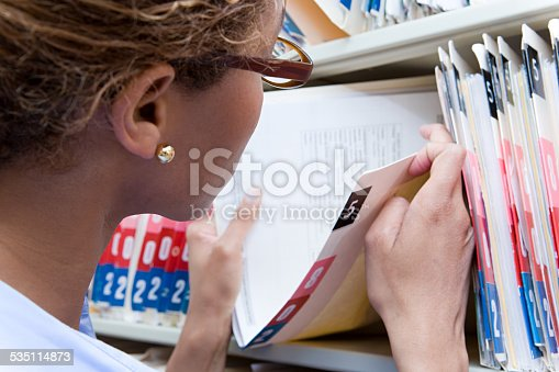 istock Administrator looking at medical record 535114873
