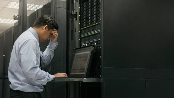 Administrator serious working with system in data center stock photo