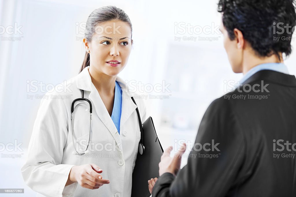 Administrator talking with a female doctor. royalty-free stock photo