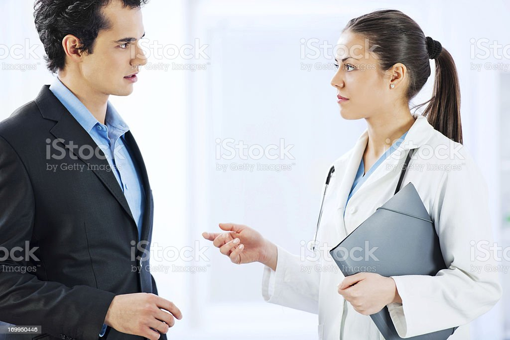 Administrator talking with female doctor. royalty-free stock photo