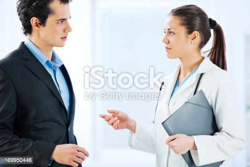 Business man and doctor communicating in the hospital.