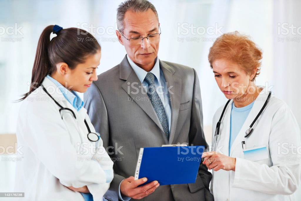 Administrator talking with Medical team at the Hospital. royalty-free stock photo
