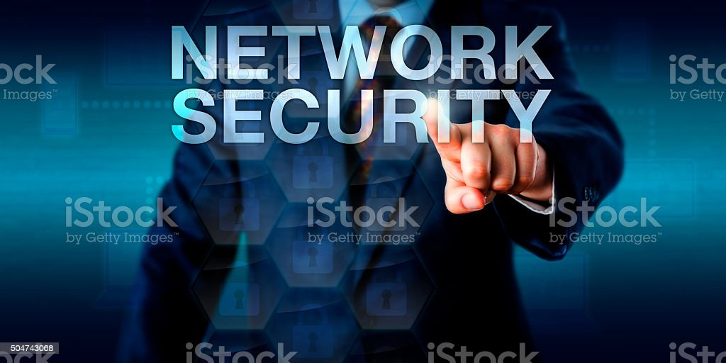 Administrator Touching NETWORK SECURITY Onscreen stock photo