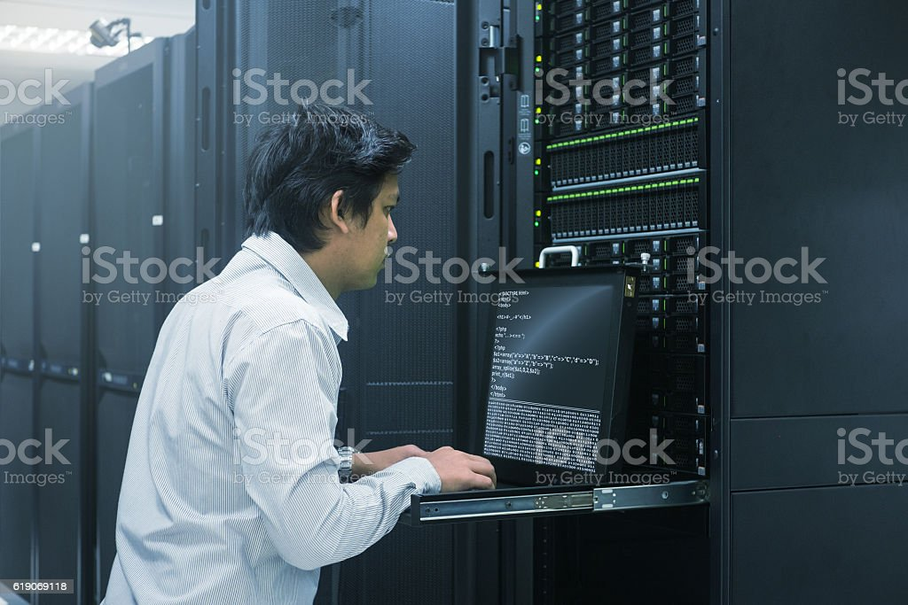 Administrator working in data center Administrator working in data center Administrator Stock Photo
