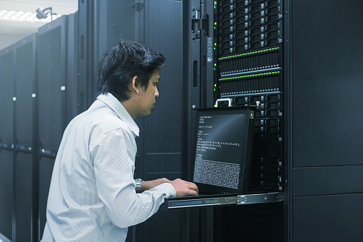 Administrator Working In Data Center Stock Photo - Download Image Now