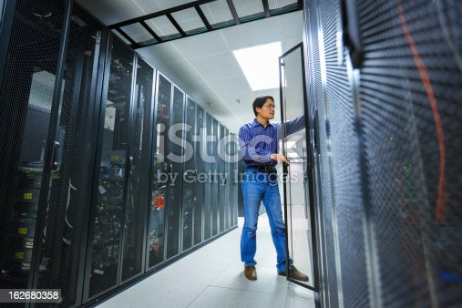 Computer Technician/network administrator working on a server