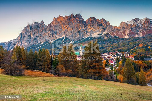 Picturesque alpine resort with majestic sunset and high snowy mountains in background, Cortina d Ampezzo, Dolomites, South Tyrol, Italy, Europe