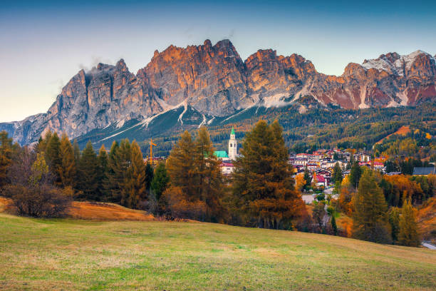 Admirable alpine cityscape with high mountains at sunset, Dolomites, Italy stock photo