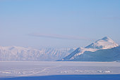 A scene in northern Baffin Island at 73 degrees north latitude.  Mountains in the distance are 20 kilometres away.  Admiralty Inlet at the village of Pond Inlet, Nunavut, Canada's arctic.