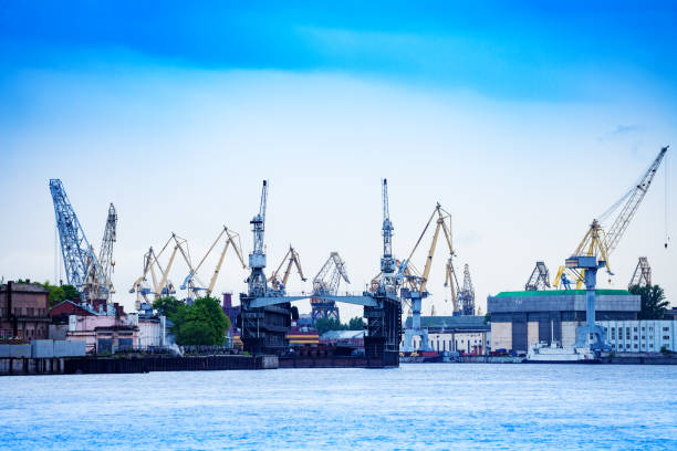 Admiralty Shipyard cranes Saint Petersburg Russia Panorama of Admiralty Shipyard or Admiralteyskiye Verfi, with construction cranes and deadweight, Saint Petersburg, Russia deadweight stock pictures, royalty-free photos & images