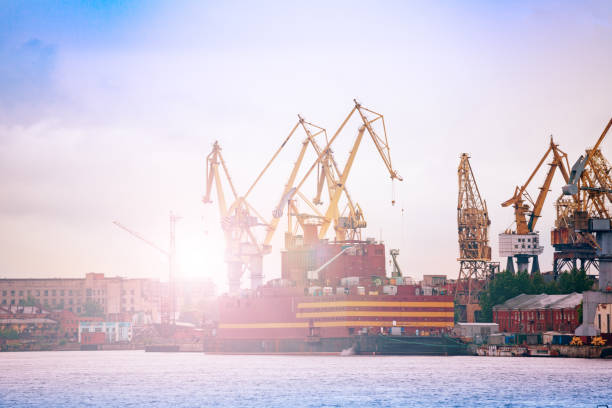 Admiralty Shipyard view in Saint Petersburg Russia Admiralty Shipyard or Admiralteyskiye Verfi, with construction cranes and deadweight, Saint Petersburg, Russia deadweight stock pictures, royalty-free photos & images