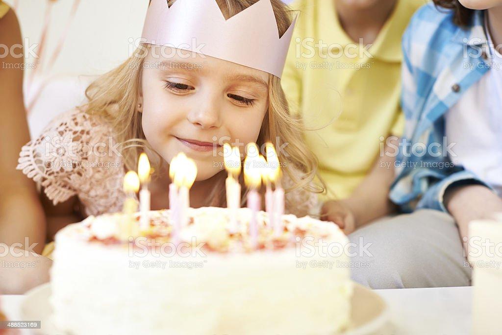 Admiring birthday candles stock photo