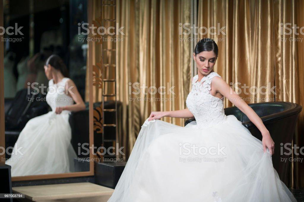 Admiring Her Wedding Dress stock photo
