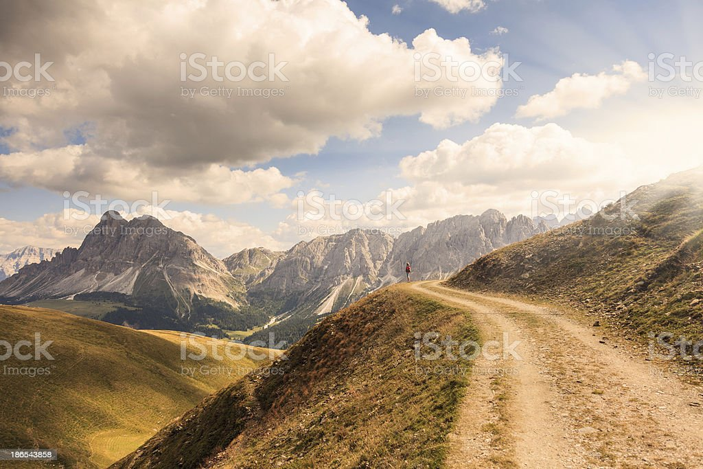 Admiring mountains scenery at sunset stock photo