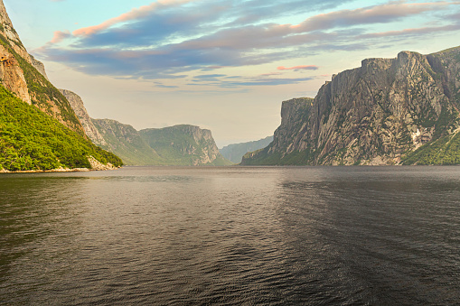 Admiring the beautiful view from the tour boat at the fjords of the Western brook pond in Gros Morne National Park, Newfoundland and Labrador, Canada.
