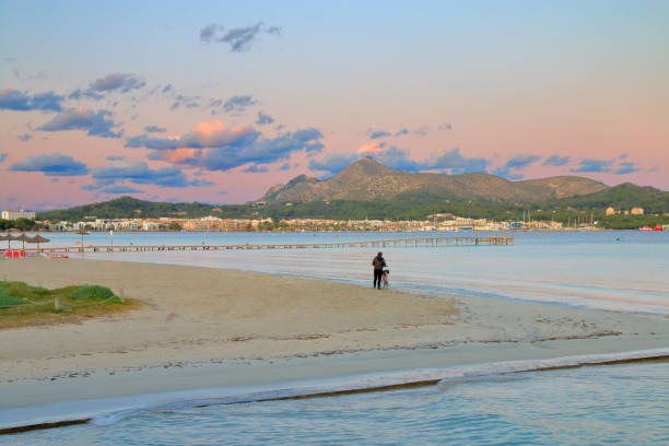 Admiring the beauty of the coast and the evening sky on the island of Palma de Mallorca.