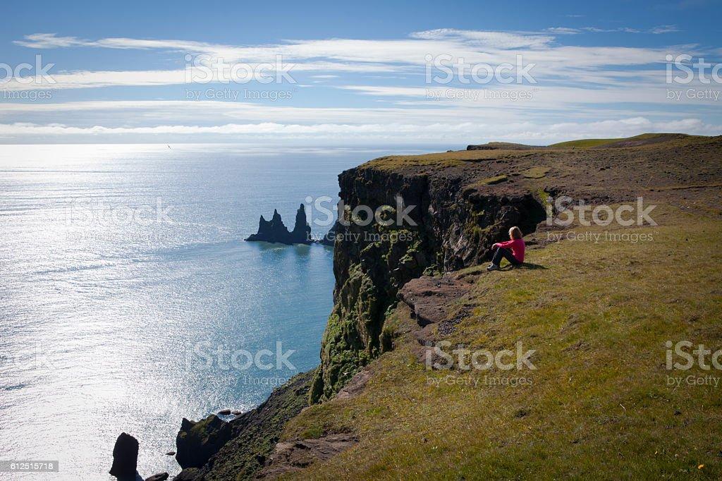 Admiring the Reynisdrangar rock formations stock photo
