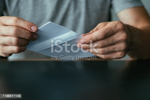 istock admission letter man envelope received mail 1166511145
