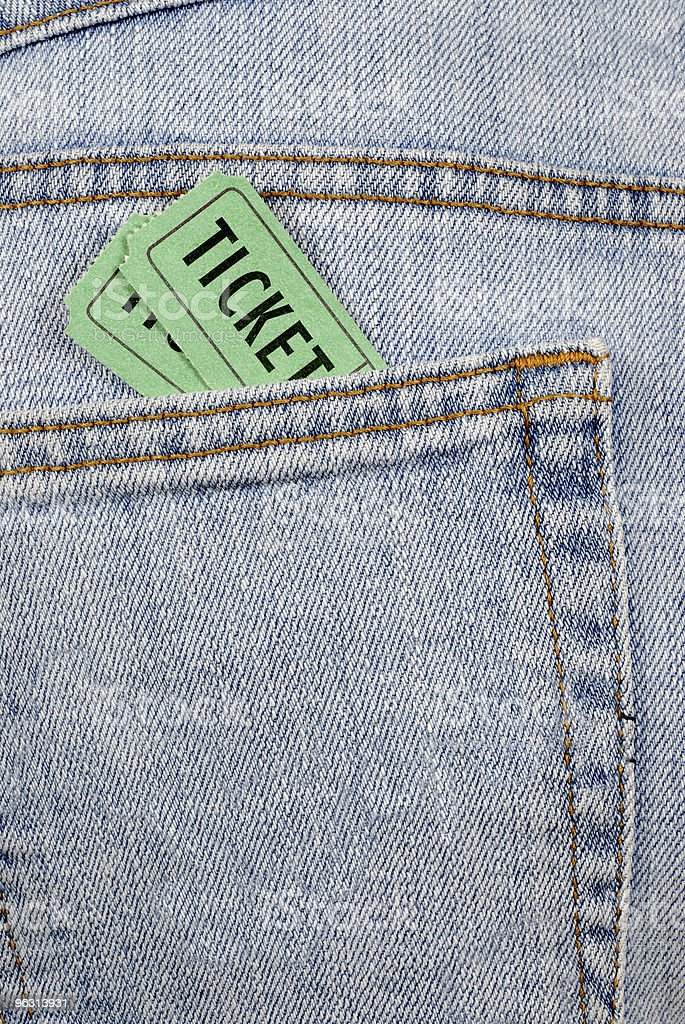 Admission tickets in denim jeans royalty-free stock photo