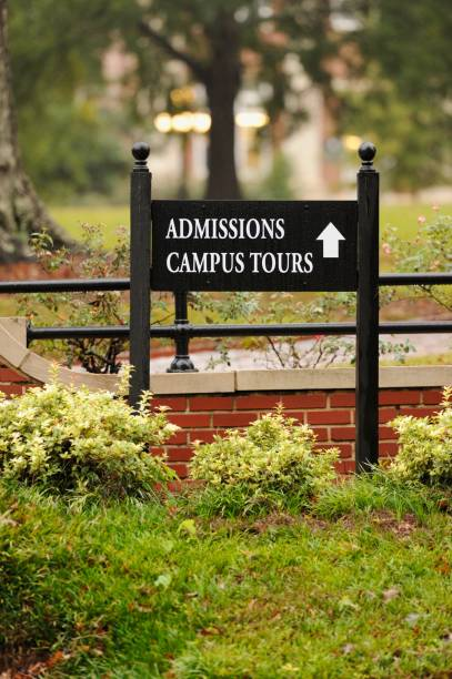 Admissions and campus tours sign near university stock photo
