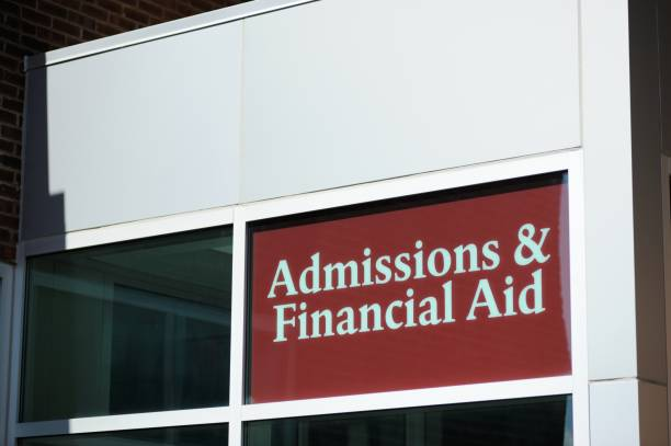 Admissions and financial aid sign stock photo