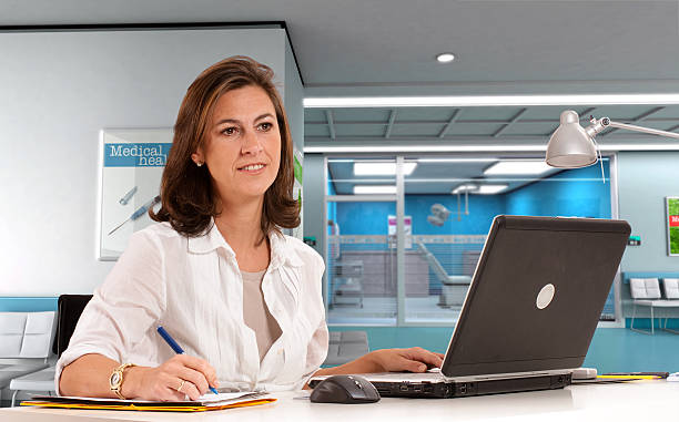 Admissions desk at the hospital  administrator stock pictures, royalty-free photos & images
