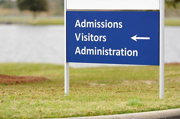 Admissions visitors administration sign stock photo