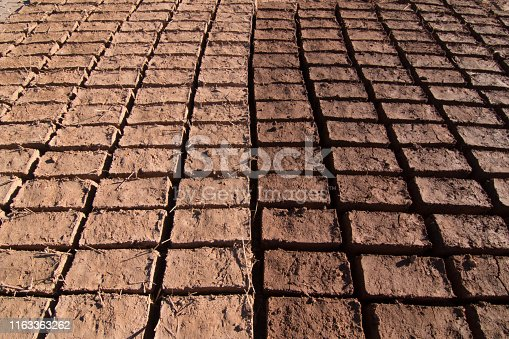 adobe bricks drying in the sun for construction in Ouarzazate forming a pattern
