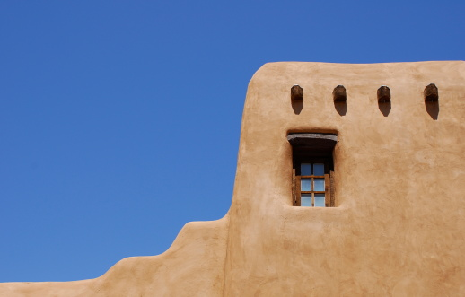 Adobe building in Santa Fe, New Mexico.  Room for copyspace in clear, blue sky.