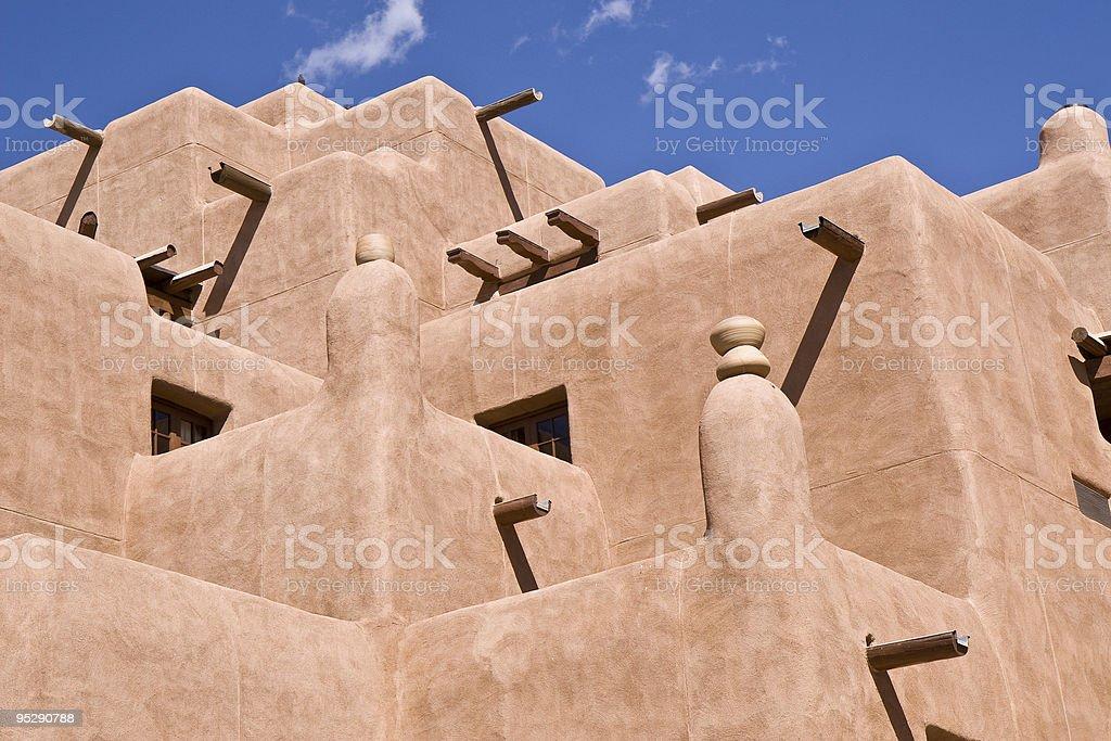 Adobe Building With Blue Sky In Santa Fe New Mexico stock photo